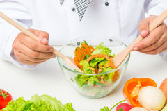 Close up chopped vegetables in a glass bowl Stock Photos