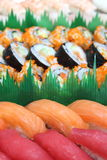 Close up the chopsticks with japanese sushi. Stock Images