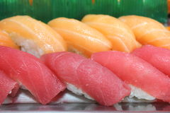 Close up the chopsticks with japanese sushi. Royalty Free Stock Photos