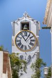 Close up of christian church clock tower. In Tavira city, Portugal Royalty Free Stock Images