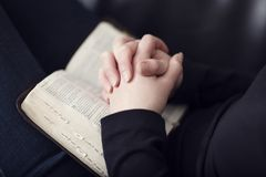 Folding Hands over a Bible Royalty Free Stock Images