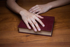 A close-up of a christian woman holding the bible. Stock Photography