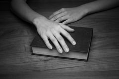 A close-up of a christian woman holding the bible. Royalty Free Stock Photo