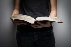 A close-up of a christian woman reading the bible. Stock Photo