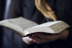Woman Read Bible. A close-up of a christian woman reading the bible. Very shallow depth of fields Royalty Free Stock Photography