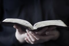 Women Reading the Bible. A close-up of a christian woman reading the bible. Very shallow depth of fields Royalty Free Stock Photos