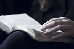 Women Reading the Bible. A close-up of a christian woman reading the bible. Very shallow depth of fields Royalty Free Stock Photo