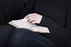 Girl reading the Bible Stock Photo