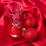 Close up christmas balls and champagne glass Royalty Free Stock Photography