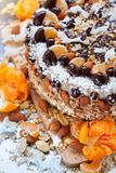 Close up of Christmas Cake Decorated with Fruits, Nuts Stock Photo