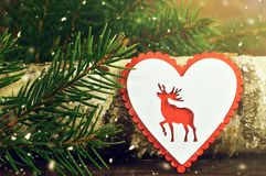 Christmas card with wooden heart ornament Stock Photos