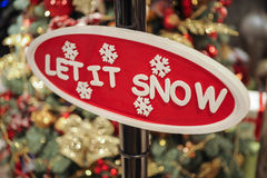 Close up of Christmas decorations. sign let it snow. Close up of Christmas decorations. Red sign let it snow royalty free stock photo