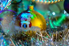 Close-up of Christmas decorations and toys with the image of a pig with a soft blurred background. stock photo