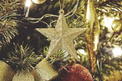 Close up on Christmas decorations on tree Stock Images