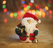 Close-up of Christmas decorative Santa Claus toy. Bokeh lights. Royalty Free Stock Photos