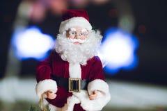 Close-up of Christmas decorative Santa Claus toy. Bokeh lights.  Stock Image