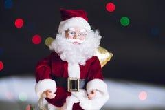 Close-up of Christmas decorative Santa Claus toy. Bokeh lights.  Stock Photos
