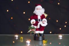 Close-up of Christmas decorative Santa Claus toy. Bokeh lights.  Stock Photography