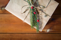 Close up of christmas gift box with fir brunch Royalty Free Stock Photo