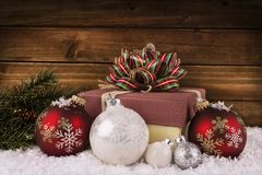 Close up on a Christmas gift box with ribbon and bow. royalty free stock photo