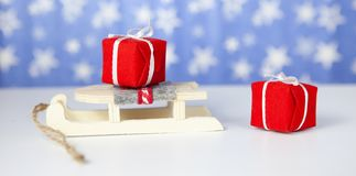 Close-up. Christmas gift boxes on santa claus sleigh, on blue background royalty free stock photography