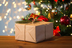 Close up of christmas gift with fir brunch Royalty Free Stock Image