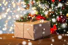Close up of christmas gift with fir brunch Royalty Free Stock Photo