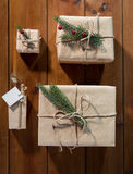 Close up of christmas gifts with fir brunch Stock Photography