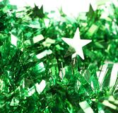 Close up of christmas green tinsel with stars Stock Photos
