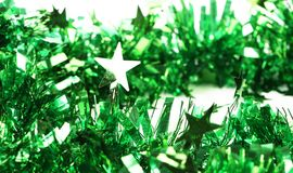 Close up of christmas green tinsel with stars Stock Photo