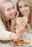 Close up of Christmas heart shape home cookies in girl's hand on Royalty Free Stock Photography