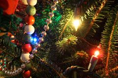 Close-up of Christmas lights and decorations on a tree stock photo