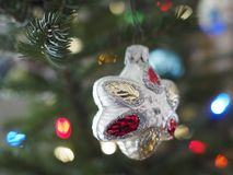 Close up of Christmas ornament. Close up of a glass Christmas ornament hanging on a fresh balsam tree royalty free stock image