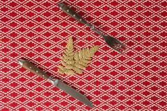Christmas ornament with fork and butter knife on table cloth. Close-up of christmas ornament with fork and butter knife on table cloth Royalty Free Stock Photo