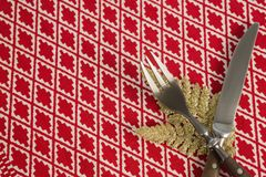 Christmas ornament with fork and butter knife on table cloth. Close-up of christmas ornament with fork and butter knife on table cloth Royalty Free Stock Photography