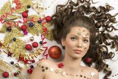 Close-up christmas portrait of brunette girl Stock Photo