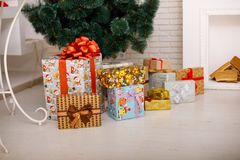 Close-up of Christmas presents under the Christmas tree. royalty free stock photo