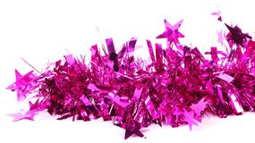 Close up of christmas purple tinsel with stars Stock Photo