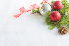 Close up of christmas red and crystal glitter balls, pine and cone over white fluffy background. Christmas decoration. Royalty Free Stock Photos