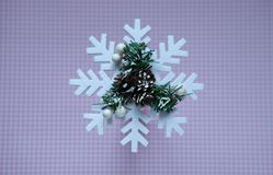 Close-up. Christmas snowflake on pink polka dot background, top view stock photo