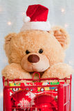 Close up of Christmas teddy bear and shopping cart Stock Images