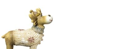 Close-up Christmas toy reindeer in sweater and hat isolated on white background with copy space royalty free stock photo