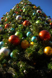 Close Up Christmas Tree. Christmas tree bulbs blue and red and yellow Royalty Free Stock Images