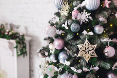 Close up Christmas tree decorated. No people. Home comfort of modern house. Stock Photos