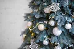 Close up Christmas tree decorated. No people. Home comfort of modern house. stock image