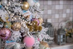 Close up of Christmas tree decoration with gold, silver,pink and white tinsel, glitter balls and a snowflake star. Close up of Christmas tree decoration with royalty free stock images