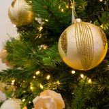Close Up Of Christmas Tree Decoration With Golden and White Ball Stock Images