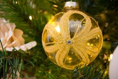 Close Up Of Christmas Tree Decoration With Golden and White Ball Stock Photo