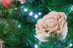 Close Up Of Christmas Tree Decoration With A Golden and White Fl. Ower On Light Background Royalty Free Stock Images