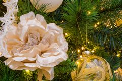 Close Up Of Christmas Tree Decoration With Golden and White Flow Stock Photography